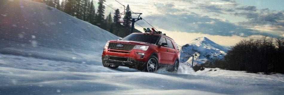Ford Explorer red during winter time